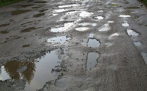Аким Караганды предлагает каждый год ремонтировать полностью дороги в каком-либо из частных секторов