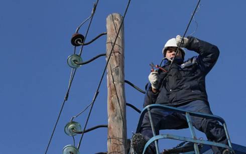 В Караганде ведутся работы по восстановлению сетей электропередач после урагана